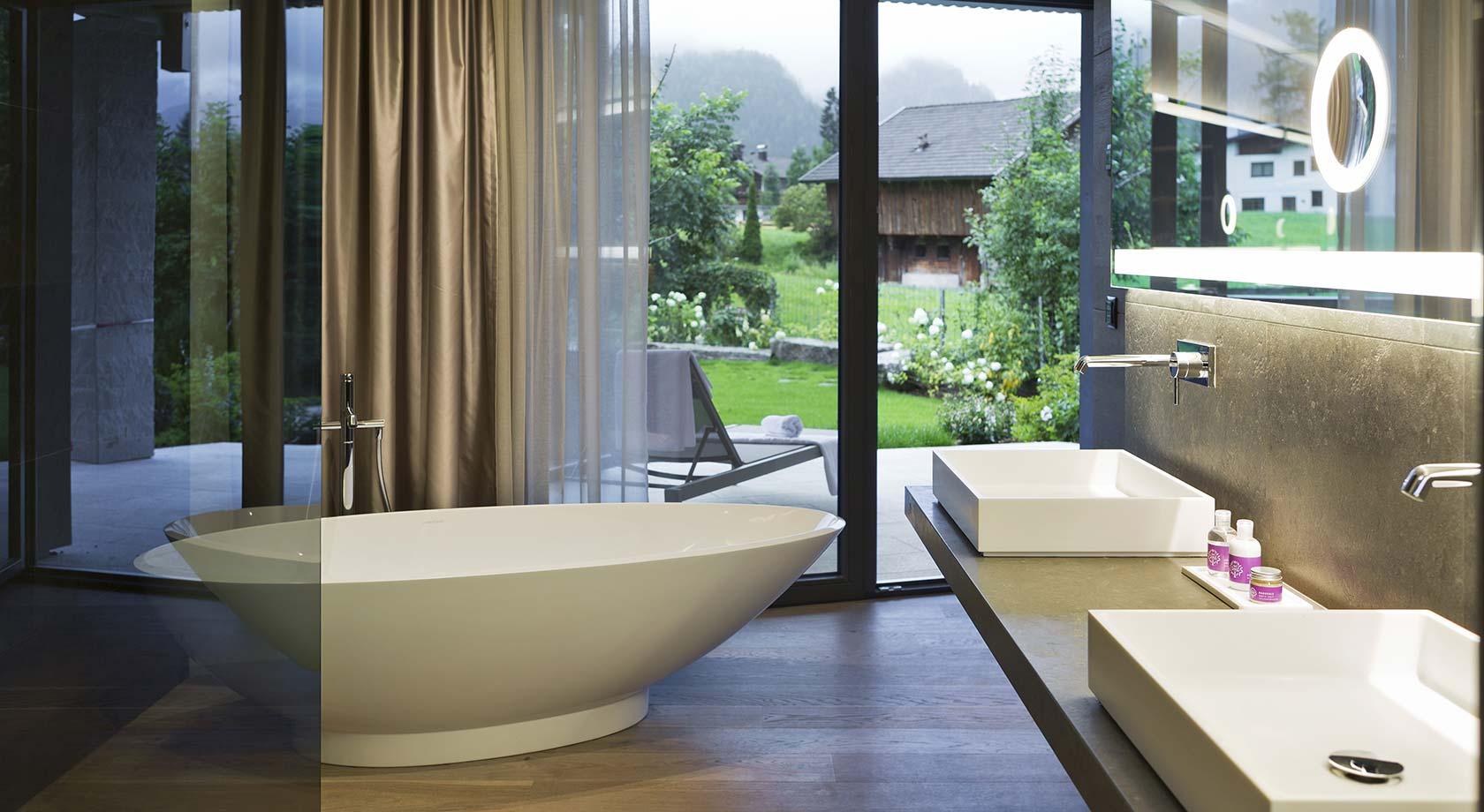 Vasche da bagno in corian rivestite in pietra arredo - Vasche da bagno su misura ...